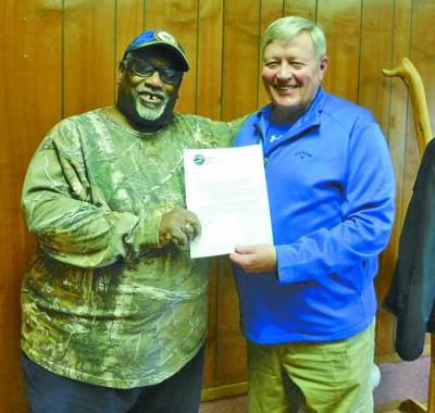 "Julius Maurice Johnson, left, poses with fellow veteran, Hot Springs Mayor George Kotti, while holding a letter showing the city's endorsement of Johnson's ""Casting Vets"" program."